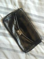 WITCHERY black leather clutch with handle and inner zipper .