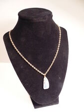 Gold colored chain necklace with polished traslucent stone