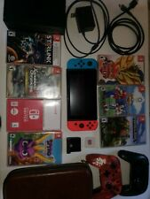 Nintendo switch bundled w/ Wires, 2 Controllers, Case, 7 Games, 128 Gb memory.