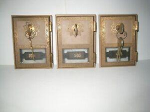 Three vintage PO mail box doors with keys