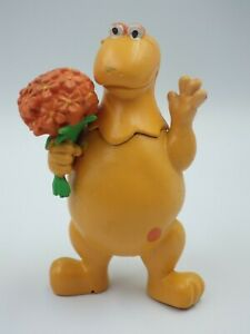 Figurine vintage casimir FLUNCH 2003 CASIMIR AVEC FLEURS 10cm publicitaire