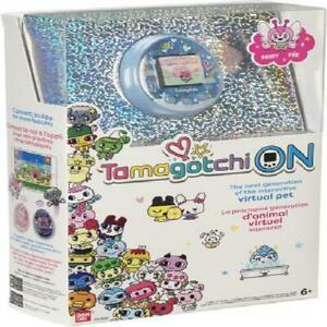 Tamagotchi On with a Fairy Theme and a Blue Shell Electronic Game Age 6+ Uni