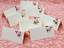 Wedding place name cards.Packs of 10.Beautiful flower decoration. White or ivory