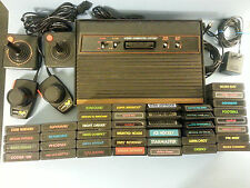 Atari 2600 4 Switch Woody Console LOT w/ 40 Games 2 Joysticks Paddle FREE SHIP