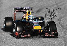 Sebastian Vettel SIGNED 12x8, F1 Red Bull RB9 . F1 Test Barcelona 2013