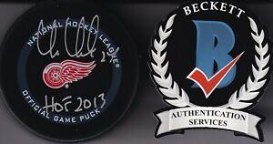 "BECKETT CHRIS CHELIOS ""HOF 2013"" SIGNED DETROIT RED WINGS REAL GAME PUCK WK78979"