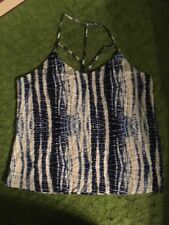blue and white tie dye tank top still with tags and is a women's size XL