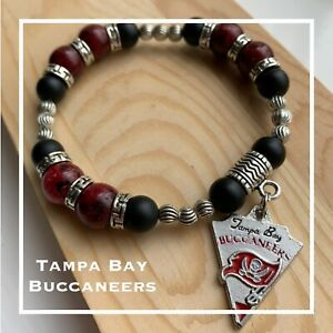 Red And Black Bracelets With Charms
