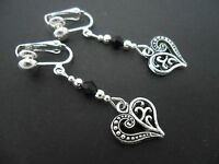 A PAIR OF DANGLY TIBETAN SILVER   HEART  & BLACK CRYSTAL CLIP ON EARRINGS.  NEW.