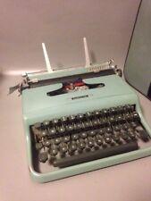 Olivetti lettera 22 vintage  typewriter in blue full working order