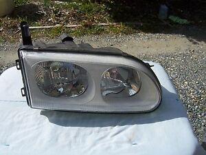 Mitsubishi Delica headlight  White background Right