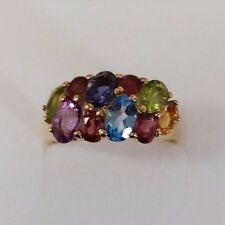 9CT YELLOW GOLD DRESS RING PERIDOT, BLUE TOPAZ, IOLITE AND AMETHYST SIZE O.
