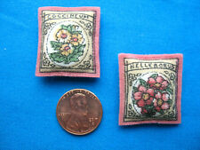 Miniature Dollhouse Pillows Resembling Tiny Flower Seed Packets