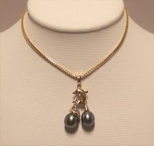 Brand new black Fresh Water Culture Pearl Pendant set in 14k solid yellow gold.