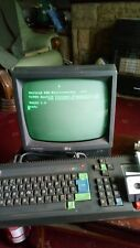 Amstrad cpc 464 computer with monitor and games