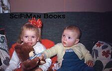 KODACHROME 35mm Slide Cute Blonde Baby Boy Girl Ribbon Teddy Bear Sofa 1960s?