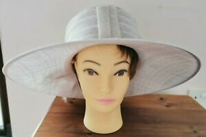 Cappelli Condici pale lilac hat with pleats, floral trim and feathers