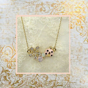 A silver sparkling flower and crystals with a lovely pink ladybird pendant