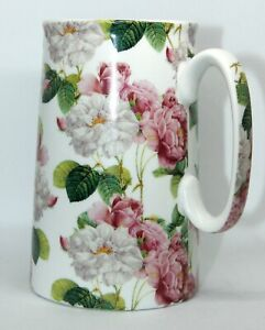 HERON CROSS POTTERY, MILK JUG WITH A PINK & WHITE FLORAL DESIGN.