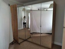 Mirrored corner wardrobe