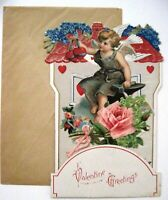 Charming Vintage Die Cut Pull Down Valentine w/ Cupid Sitting On Anvil   *