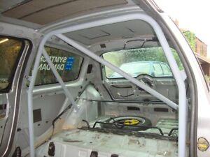 Escort 1/2 fiesta/clio/cortina/100e/105e roll cage . track day +std cage bolt in