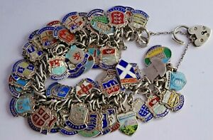 Vintage solid silver charm bracelet & 61 British enamel travel town shields. 97g