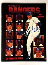 1991 Nolan Ryan Autographed Texas Rangers Yearbook  MLB Baseball Strikeout