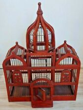 Antique to vintage bird cage made of wood and metal