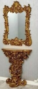 gold console table and mirror.Console: 76 x 70 x 107 cmMirror: 80 x 3.6 x 85 c