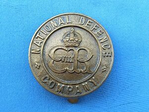 The National Defence Company cap badge.