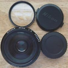 Nikon Nikkor Ais 35mm 1:2. Comes with caps and filter Uv. Nice