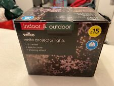 Indoor and outdoor white projector lights. Christmas lights