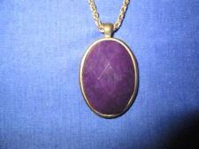 Kette L:ca. 54 cm mit ovalem Anhänger B:ca.2,4 cm H:ca.3,2 cm Amethyst ? violett
