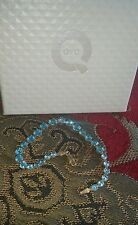 QVC  14K Yellow Gold Graduated Round Cut Blue Topaz Tennis Bracelet 7.25
