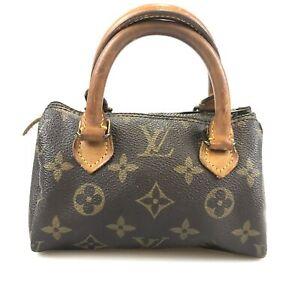 100% authentic Louis Vuitton Monogram Mini Speedy M41534 handbag used 167-1-t