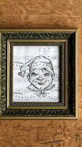 original ink painting of child on old note paper and framed in wooden frame