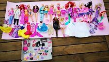 Enorme lot de barbie + accessoires + robes