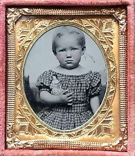1/16 PLATE TINTYPE - DOLL SIZE IMAGE OF A DOLL FACED CHILD HOLDING A CHINA DOLL