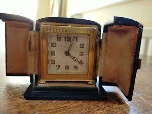 Antique Zenith Metal Dore Alarm Clock In Original blue Case in working.