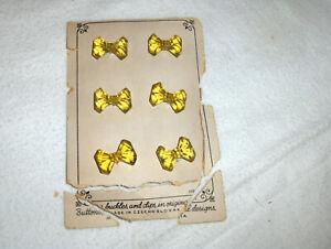 Vintage Set of 4 yellow glass Czechoslovakia Buttons on original card
