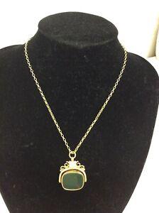 JTJ Birmingham hallmarked 9 carat gold spinner pendant necklace with green stone