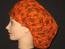 Surgical Scrub Hats/Caps Halloween Black Spiders on Orange with sparkly eyes