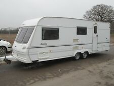 LUNAR DELTA 580-4 FOUR BERTH TWIN AXLE 2001 TOURING CARAVAN, SMART AND SPACIOUS