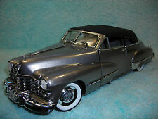1/18 DIECAST 1947 CADILLAC SERIES 62 CABRIOLET TOP UP IN PLATINUM BY ANSON.
