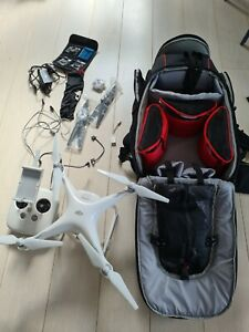 Dji Phantom 4 Drone with Car Charger, Filters, Carbon Fiber blades, and Rucksack