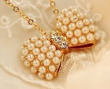 Gold tone bow and pink / white pearl necklace