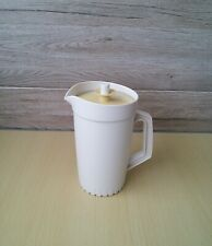 VINTAGE TUPPERWARE A LARGE 2litre JUG WITH PUSH BUTTON SEAL. BEIGE / MUSTARD LID