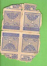 #D306.  FOUR WWII AUSTRALIAN  2 GALLON  PETROL RATION COUPONS, DAMAGED