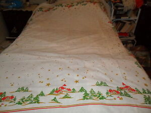 VINTAGE CHRISTMAS SNOW TABLECLOTH-STARS EVERGREENS HOUSES & CHURCHES-COTTON